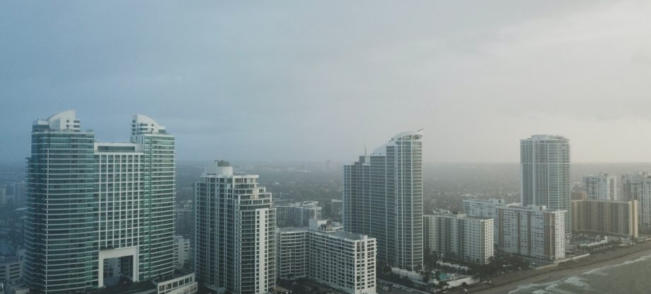 bird's eye view photography of high-rise buildings under gray sky